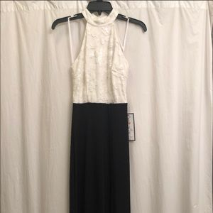 Black and a White Gown with Tags Attached